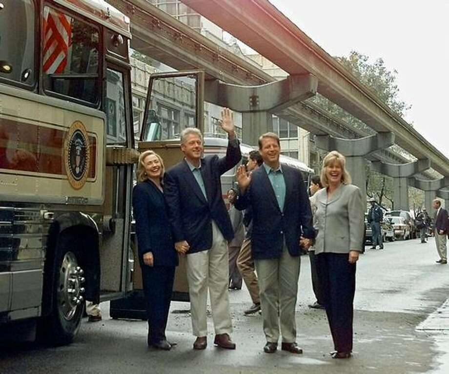 The Sept. 19, 1996 photo caption read: President Clinton waves as he boards a bus with First Lady Hillary Rodham Clinton, Vice President Al Gore, and Gore's wife Tipper in Seattle. Photo: P-I File
