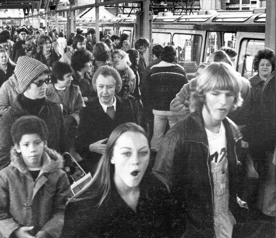 The 1975 Black Friday caption read: The monorail attracted the greatest group of bargain hunters yesterday. Photo: P-I File