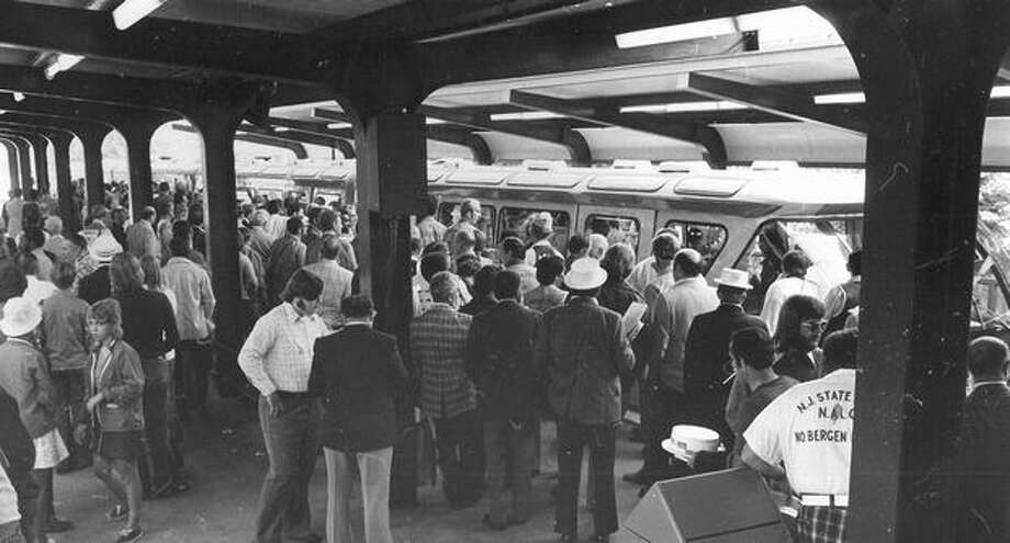 The Aug. 12, 1974 caption read: Several thousand postal workers jammed the monorail cars as they head into downtown Seattle for lunch and mid-day break from heavy business meetings at the Seattle Center coliseum. Photo: P-I File