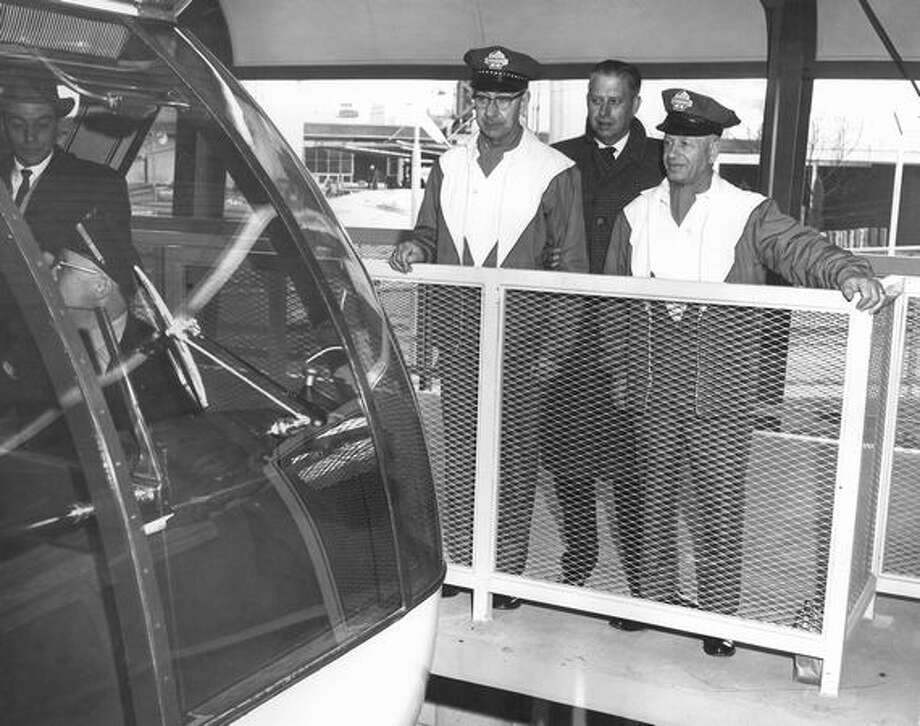 The 1962 photo caption read: Thomson and Hordan are old-time street car men now running the monorail train. Photo: P-I File