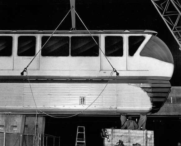 A section of the first monorail train to arrive in Seattle sits on the track, still connected by cable to crane which lifted it into position, Feb. 20, 1962. Photo: P-I File