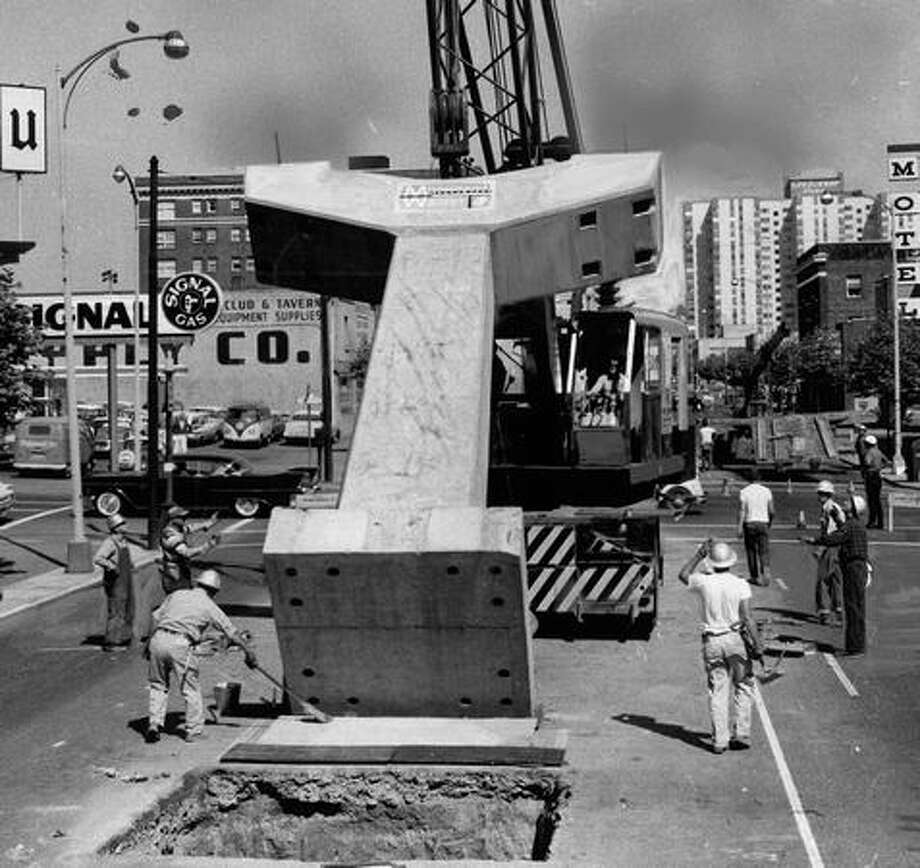 A crane lifts a Monorail column into place, June 2, 1961. Photo: P-I File