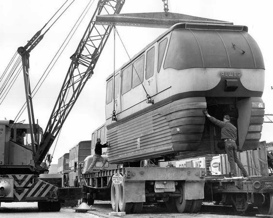 The March 26, 1962 photo caption read: The second monorail train arrived and was unloaded at Terry and Republican. Photo: P-I File