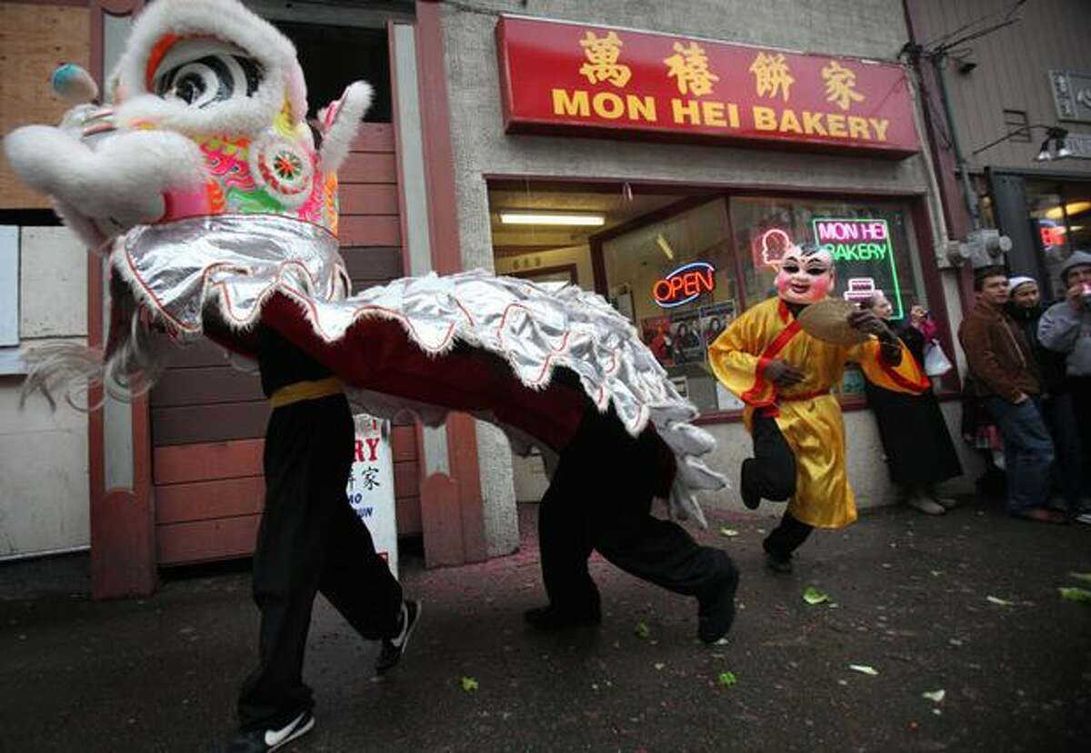 Members of the Mak Fai Washington Kung Fu Club perform a lion dance during the Year of the Rabbit Lunar New Year celebration in Seattle's International District.