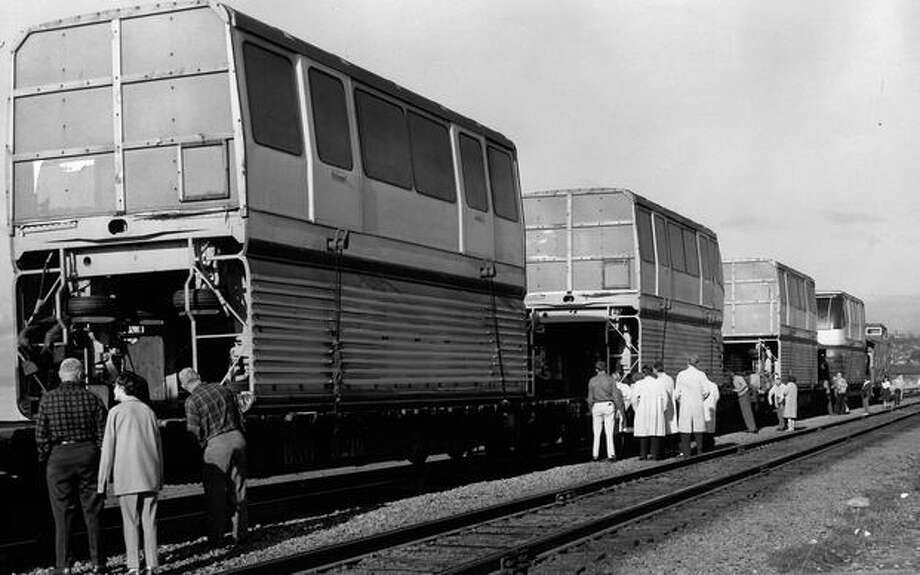 The Feb. 1962 photo caption read: Sighseers peer at newly arrived Monorail on tracks behind Crawfords Restaurant this morning. Photo: P-I File