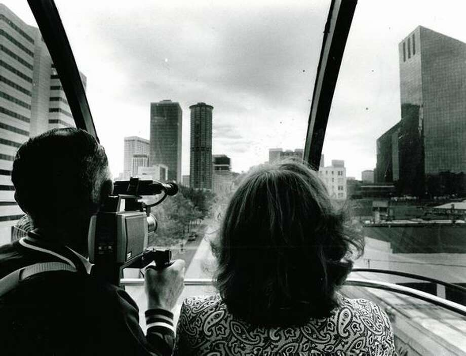 Bob and Ginny Turner of Illinois film the sights during their Monorail ride on Aug. 3, 1983. Photo: P-I File