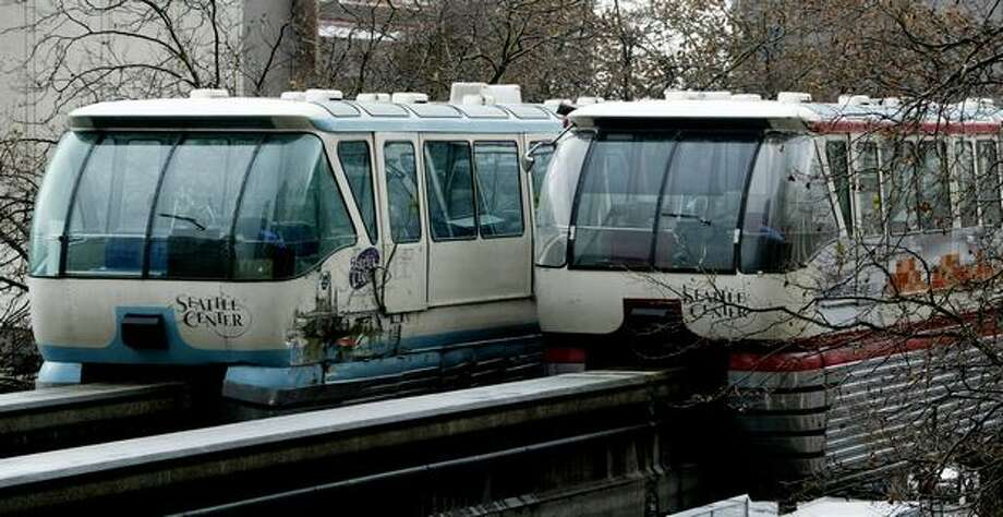 The two Monorail trains are parked the day after a Nov. 28, 2005 collision. (Dan DeLong/Seattlepi.com file) Photo: P-I File