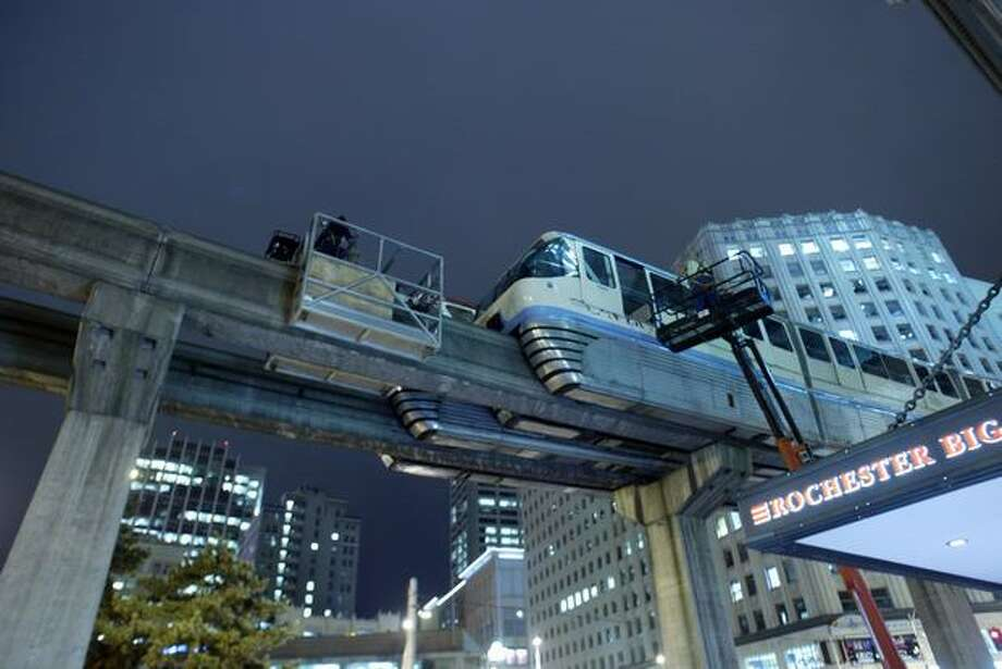 Monorail workers prepare to hook cables to the cars after they crashed Nov. 24, 2005. (Phil H. Webber/Seattlepi.com file) Photo: P-I File