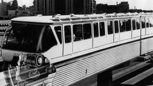 A 1962 Firestone illustration of the Seattle Monorail showing how the tires ride on the concrete tracks.