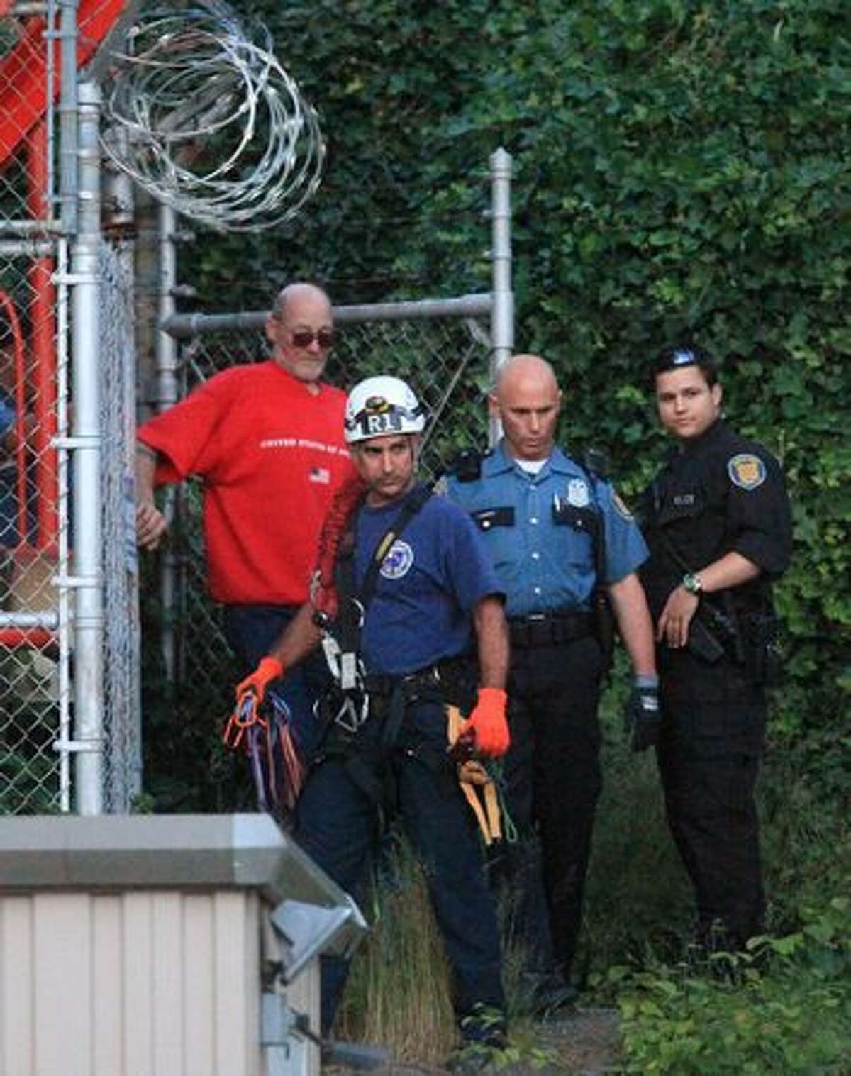The unidentified man is taken into custody after he climbed to the top of the 609-foot KIRO/7 Television tower.