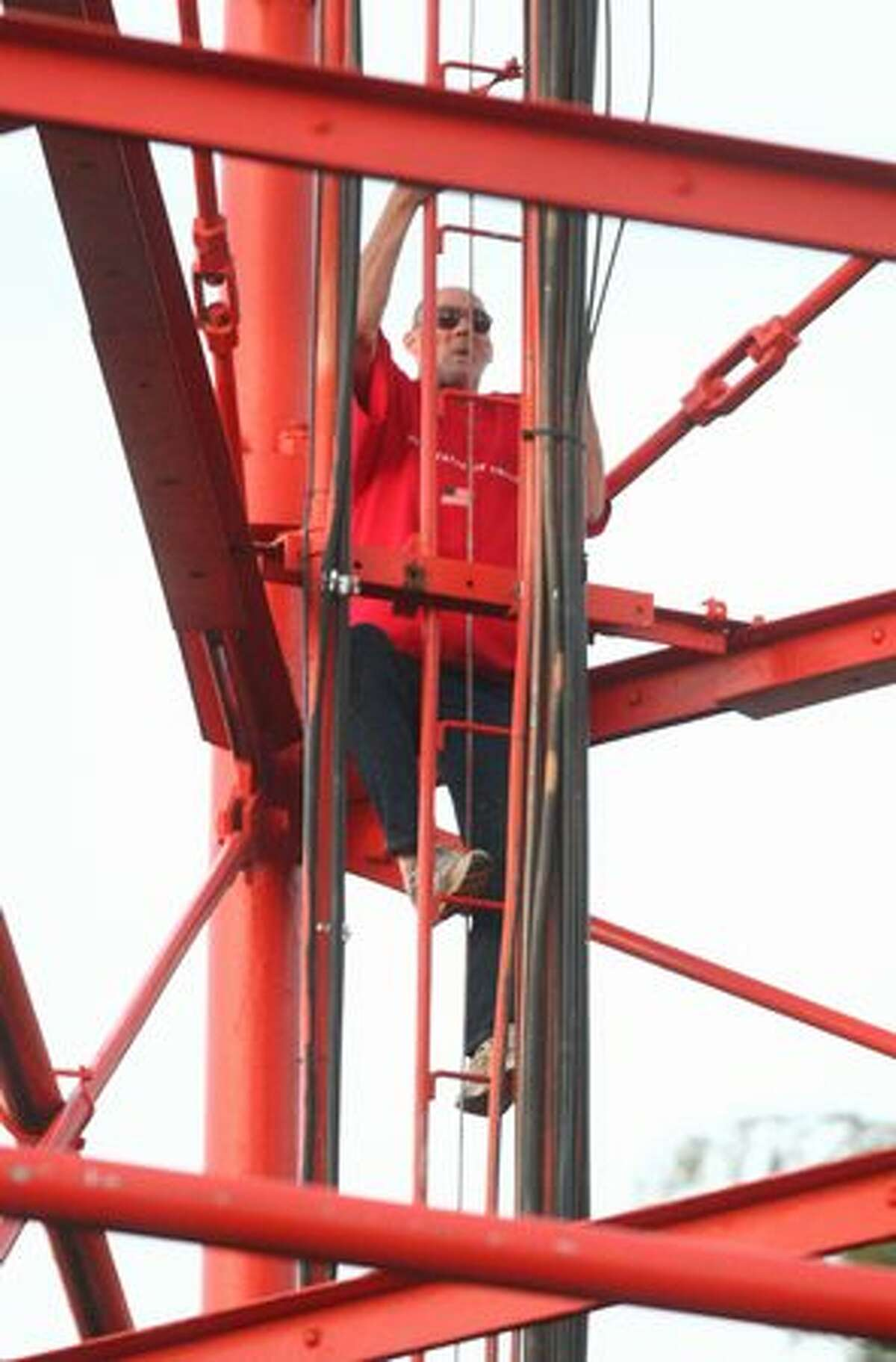 An unidentified man climbs down from the top of the KIRO/7 Television tower on Seattle's Queen Anne hill.