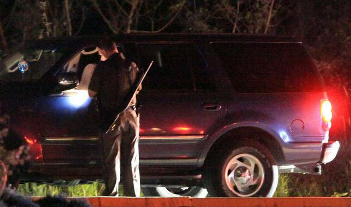 Police interview and inspect cars leaving Lake Sammamish State Park after a shooting left at least two dead and four others wounded Saturday night. There were hundreds of people gathered on the beach around dusk when the shooting occurred. Police said the scene descended quickly into chaos.