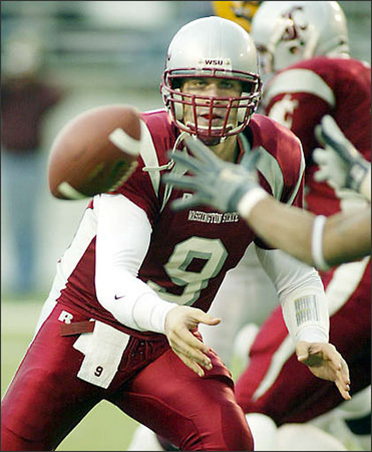 Washington State backup quarterback Josh Swogger pitches the ball in the second quarter against Arizona State, Saturday, Nov. 15, 2003, at Martin Stadium in Pullman. Swogger came into the game to replace quarterback Matt Kegel, who was injured last week against UCLA but played into the second quarter Saturday before being replaced by Swogger. (AP Photo/Ted S. Warren)