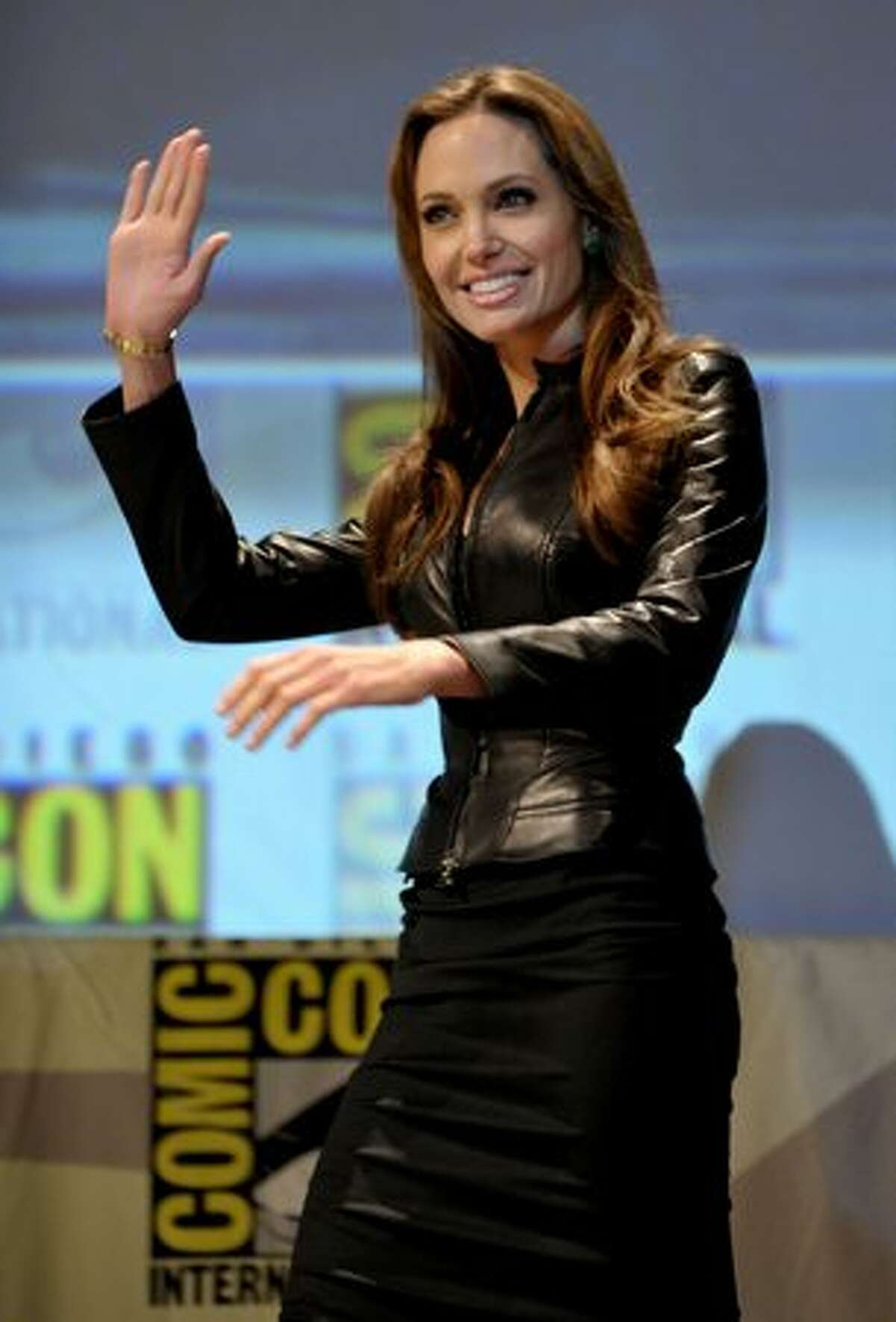 """Actress Angelina Jolie walks onstage at the """"Salt"""" panel during Comic-Con 2010 at San Diego Convention Center in San Diego, California. (Photo by Kevin Winter/Getty Images)"""