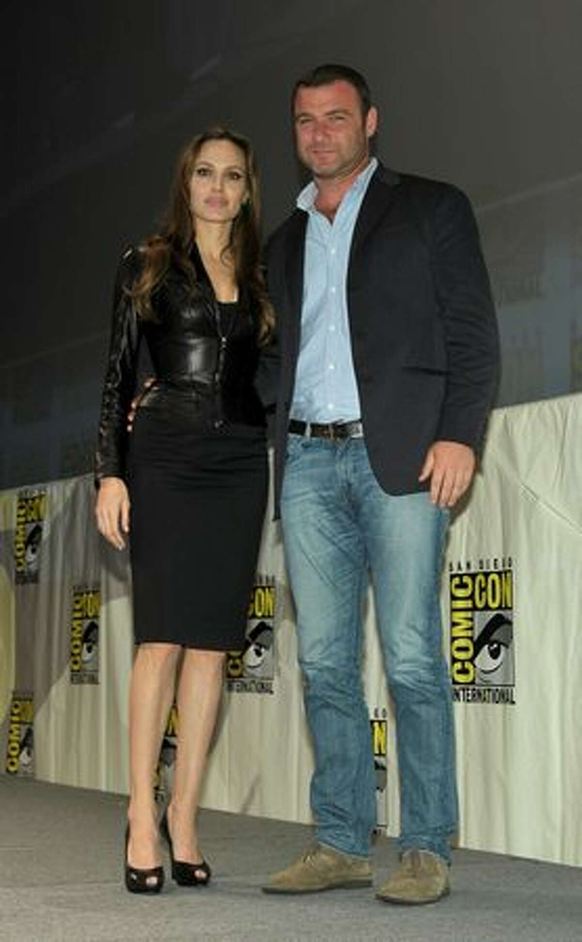 Actress Angelina Jolie (L) and actor Liev Schreiber pose onstage at the