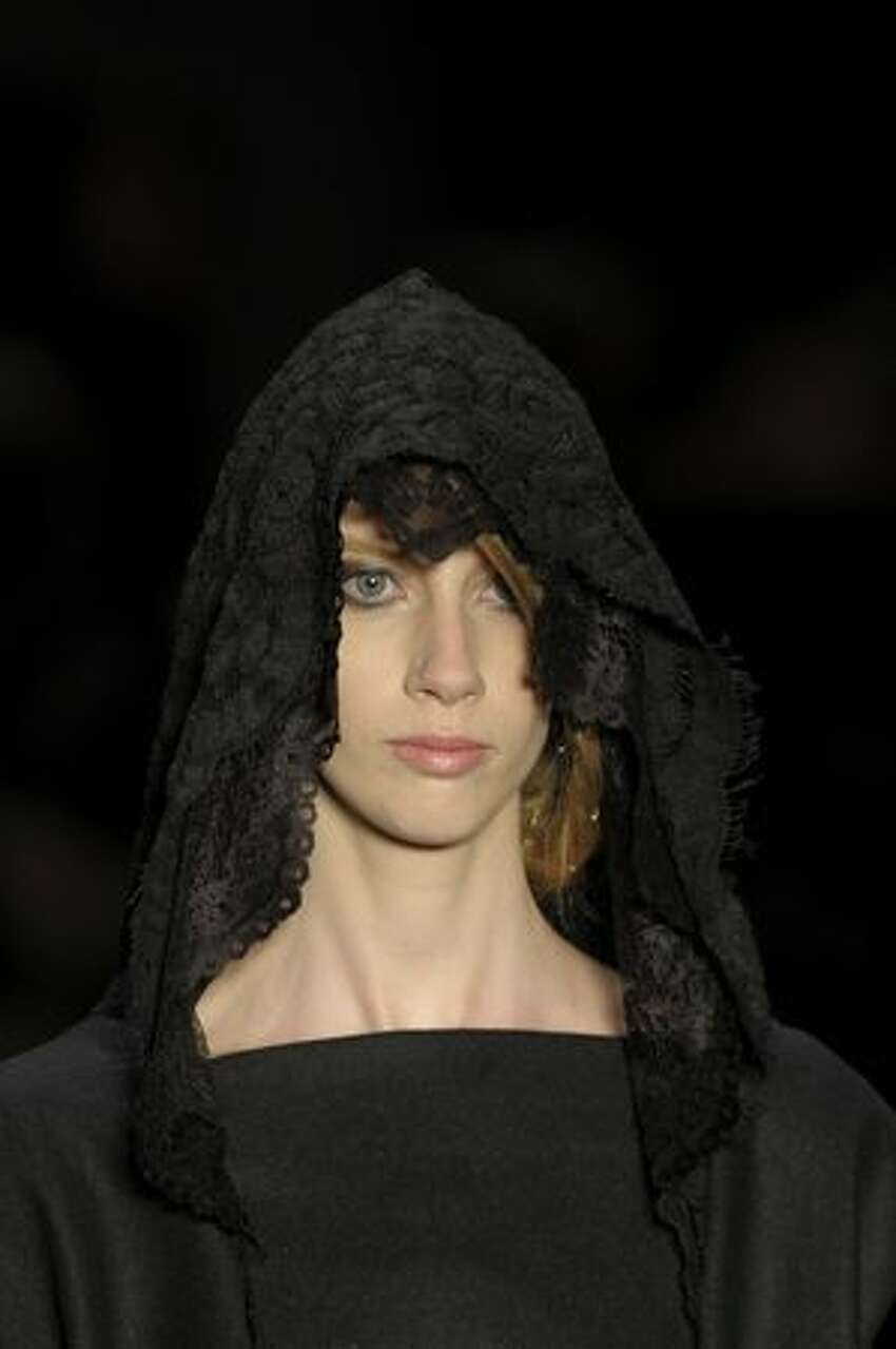 A model presents a creation by designer Alexandre Herchcovitch during the 2011-2012 Fall-Winter collections of the Sao Paulo Fashion Week in Sao Paulo, Brazil.
