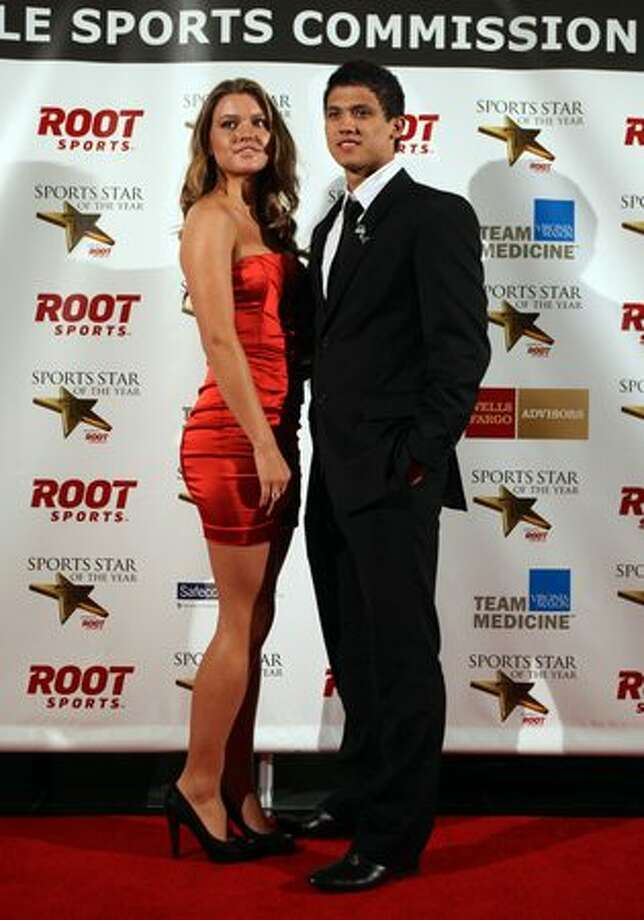 Seattle Sounders star Fredy Montero stops on the red carpet with his girlfriend Alexis Immig during the 76th annual Seattle Sports Star of the Year Awards on Wednesday at Benaroya Hall in Seattle. Photo: Joshua Trujillo, Seattlepi.com