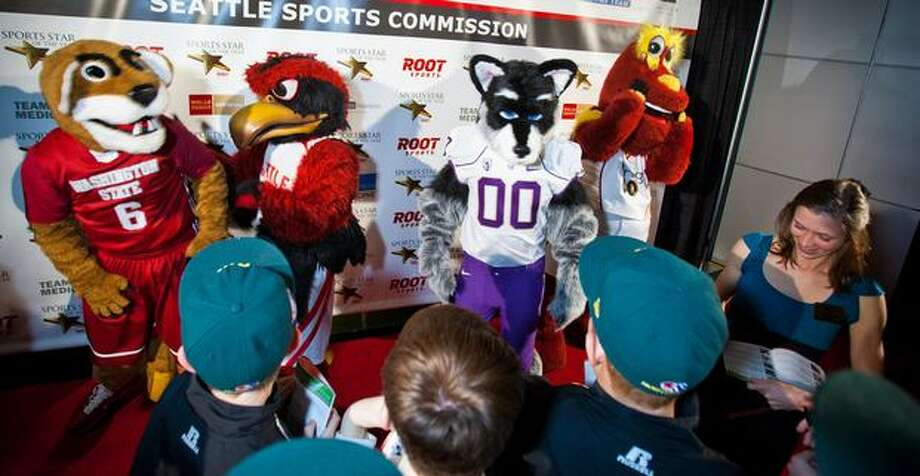 Northwest sports team mascots take over the red carpet at the 76th Annual Sports Star of the Year, presented by ROOT SPORTS, at Benaroya Hall in Seattle Wednesday, Jan. 26, 2011. At far right is University of Washington runner Katie Follett, nominated for 2010 female sports star of the year. The evening honors Northwest sports stars, carrying on an annual tradition started by Seattle Post-Intelligencer sports editor Royal Brougham in 1936. Photo: Dan DeLong, RedBox Pictures