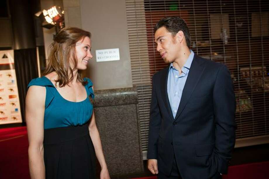 Team U.S.A. short-track speed skater Apolo Ohno, nominated for 2010 male sports star of the year, chats with University of Washington runner Katie Follett, nominated for 2010 female sports star of the year, upon arrival at the 76th Annual Sports Star of the Year, presented by ROOT SPORTS, at Benaroya Hall in Seattle Wednesday, Jan. 26, 2011. The evening honors Northwest sports stars, carrying on an annual tradition started by Seattle Post-Intelligencer sports editor Royal Brougham in 1936. Photo: Dan DeLong, RedBox Pictures