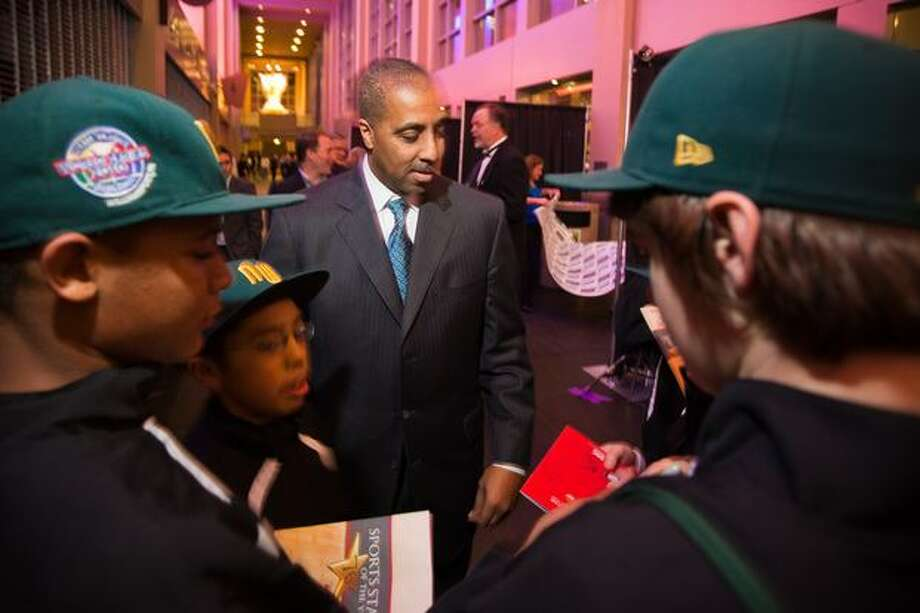 Washington Huskies head basketball coach Lorenzo Romar signs autographs for Auburn All-Stars players prior to the 76th Annual Sports Star of the Year, presented by ROOT SPORTS, at Benaroya Hall in Seattle Wednesday, Jan. 26, 2011. The evening honors Northwest sports stars, carrying on an annual tradition started by Seattle Post-Intelligencer sports editor Royal Brougham in 1936. Photo: Scott Eklund, Red Box Pictures