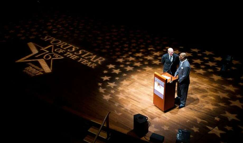 Sports radio host Kevin Calabro and former Seattle SuperSonics great Gary Payton speak before announcing the winner of the 2010 Professional Sports Star of the Year, San Francisco Giants pitcher Tim Lincecum, during the 76th Annual Sports Star of the Year, presented by ROOT SPORTS, at Benaroya Hall in Seattle Wednesday, Jan. 26, 2011. The evening honors Northwest sports stars, carrying on an annual tradition started by Seattle Post-Intelligencer sports editor Royal Brougham in 1936. Photo: Dan DeLong, RedBox Pictures