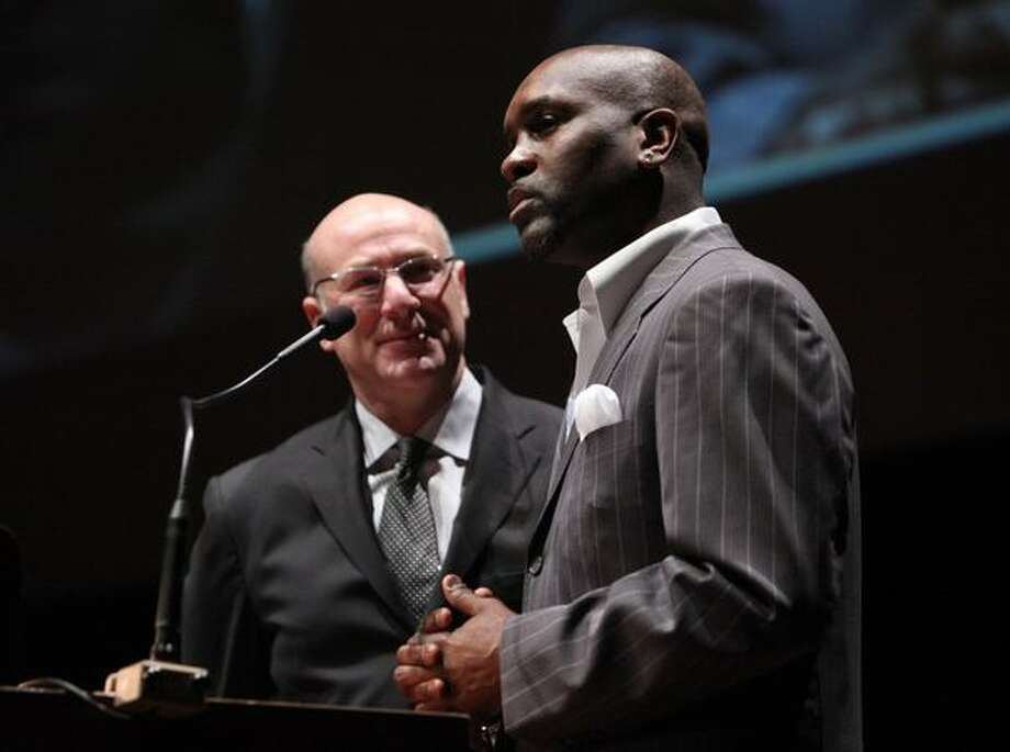 Kevin Calabro listens as Gary Payton talks about his days as a SuperSonic and the possibility of a return of the NBA to Seattle during the 76th annual Seattle Sports Star of the Year Awards on Wednesday at Benaroya Hall in Seattle. Photo: Joshua Trujillo, Seattlepi.com