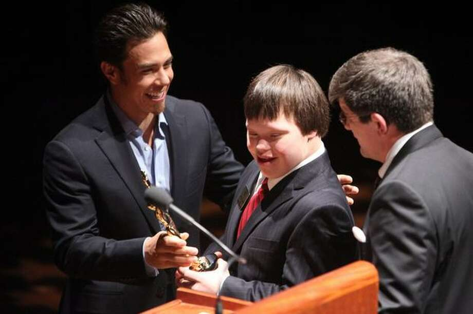 Apolo Ohno gives the Seattle Children's Inspirational Youth Award to Snohomish High School football player Ike Ditzenberger during the 76th annual Seattle Sports Star of the Year Awards on Wednesday at Benaroya Hall in Seattle. Photo: Joshua Trujillo, Seattlepi.com