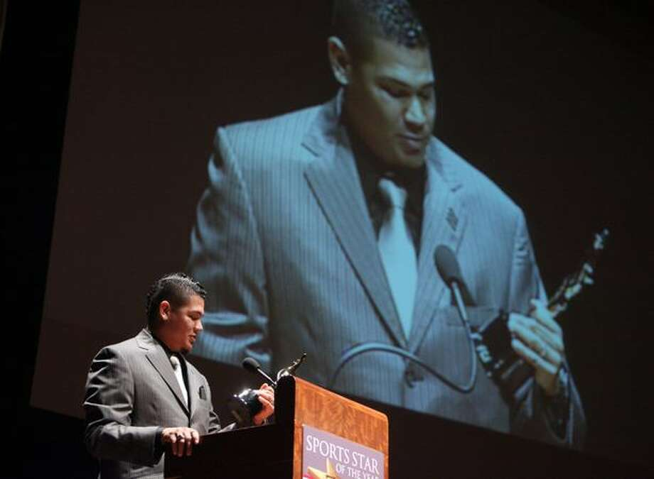 Seattle Mariner Felix Hernandez, winner of the 2010 Cy Young Award, accepts an award for Sports Story of the Year during the 76th annual Sports Star of the Year Awards on Wednesday at Benaroya Hall in Seattle. Photo: Joshua Trujillo, Seattlepi.com