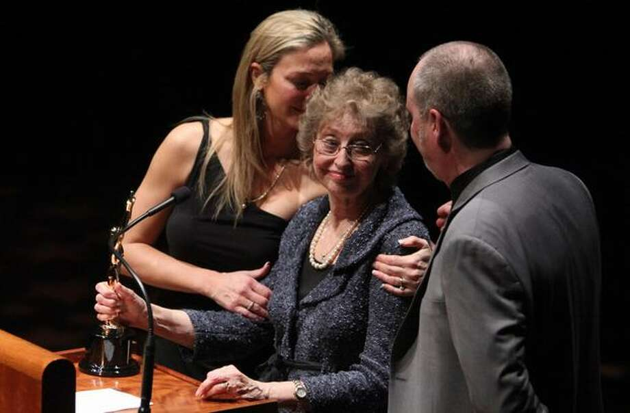 From left, Greta Niehaus Dunn, Marilyn Niehaus and Andy Niehaus accept an award for the late Dave Niehaus during the 76th annual Seattle Sports Star of the Year Awards on Wednesday at Benaroya Hall in Seattle. Niehaus, the voice of the Seattle Mariners who died in 2010, was honored with the Keith Jackson Award. Photo: Joshua Trujillo, Seattlepi.com