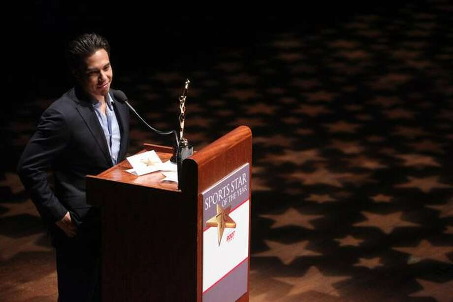 Apolo Ohno accepts the 2010 Male Sports Star of the Year award during the 76th annual Seattle Sports Star of the Year Awards on Wednesday at Benaroya Hall in Seattle. Photo: Joshua Trujillo, Seattlepi.com