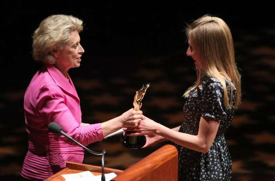 Governor Chris Gregoire awards Jessica Pixler of Seattle Pacific University the 2010 Female Sports Star of the Year award during the 76th annual Seattle Sports Star of the Year Awards on Wednesday at Benaroya Hall in Seattle. Pixler is a crosscountry and track and field athlete. Photo: Joshua Trujillo, Seattlepi.com