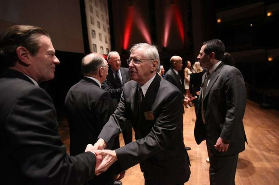 1962 award recipient John O'Brien shakes hands with emcee Pat Cashman during the 76th annual Seattle Sports Star of the Year Awards on Wednesday at Benaroya Hall in Seattle. Photo: Joshua Trujillo, Seattlepi.com