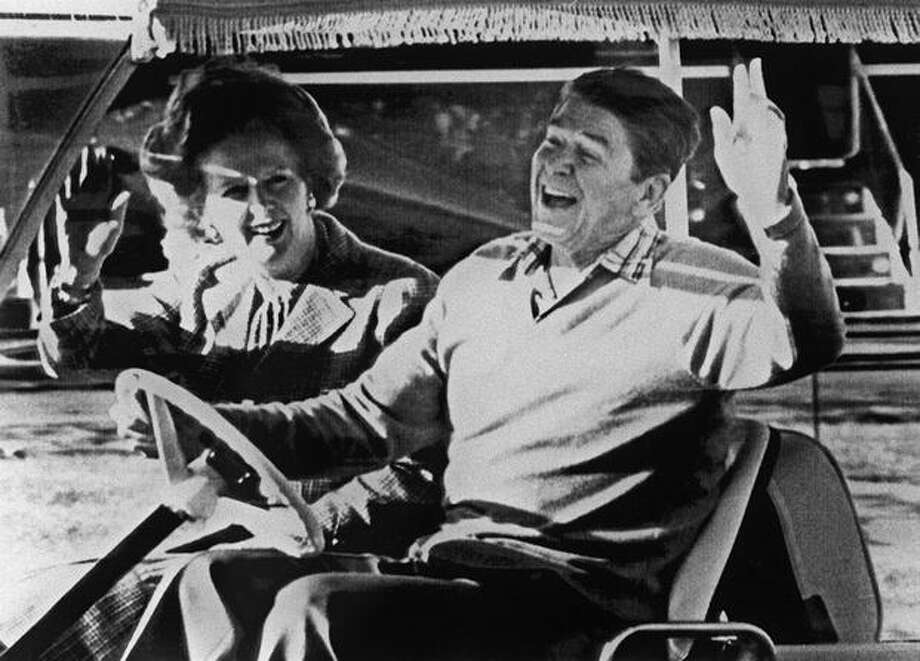 Ronald Reagan and Margaret Thatcher wave after their arrival in Camp David, Dec. 22, 1984, before their meeting. Photo: Getty Images