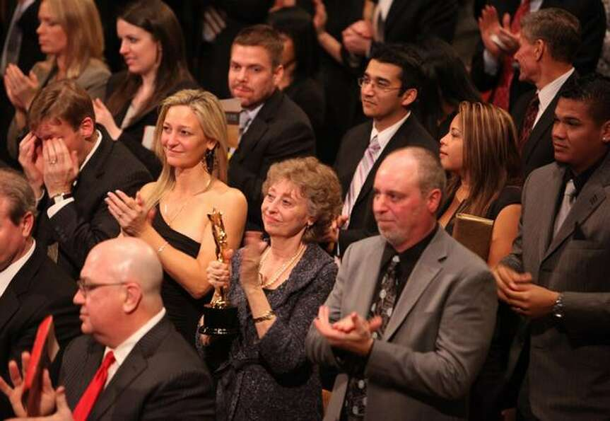 From left, Greta Niehaus Dunn, Marilyn Niehaus and Andy Niehaus applaud during a presentation at the