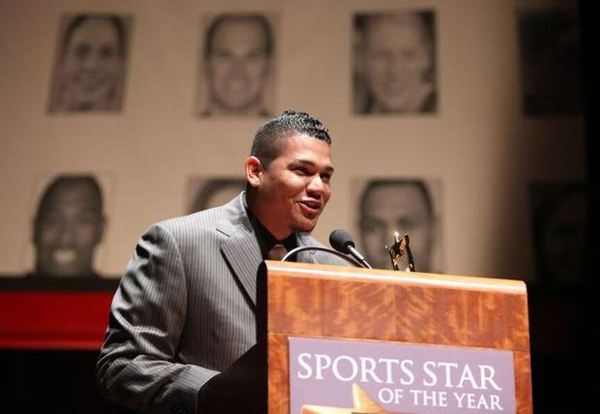 Seattle Mariner Felix Hernandez, winner of the 2010 Cy Young Award, accepts an award for Sports Stor