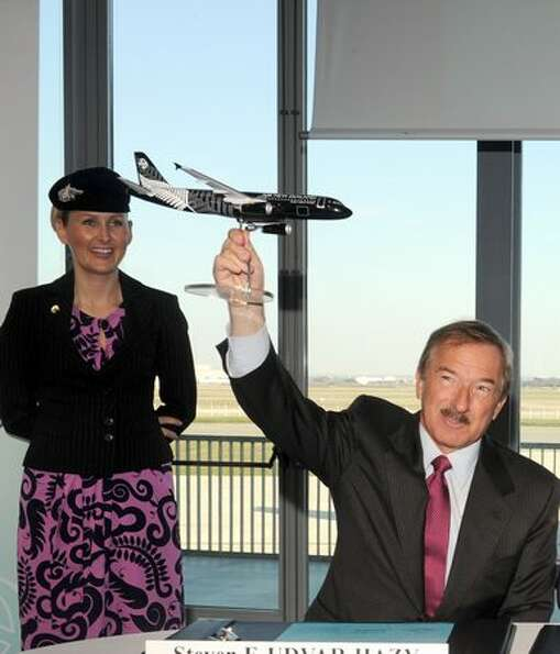 Air Lease Corporation President Stevan Udvar-Hazy holds an Airbus model as he attends a press confer