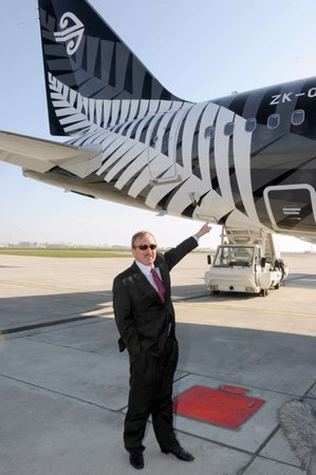 Air Lease Corporation President Stevan Udvar-Hazy poses in front of an A320 Airbus painted with the logo of New Zealand rugby national team, the All Blacks during its delivery to ALC on January 28, 2011 in Colomiers, France.