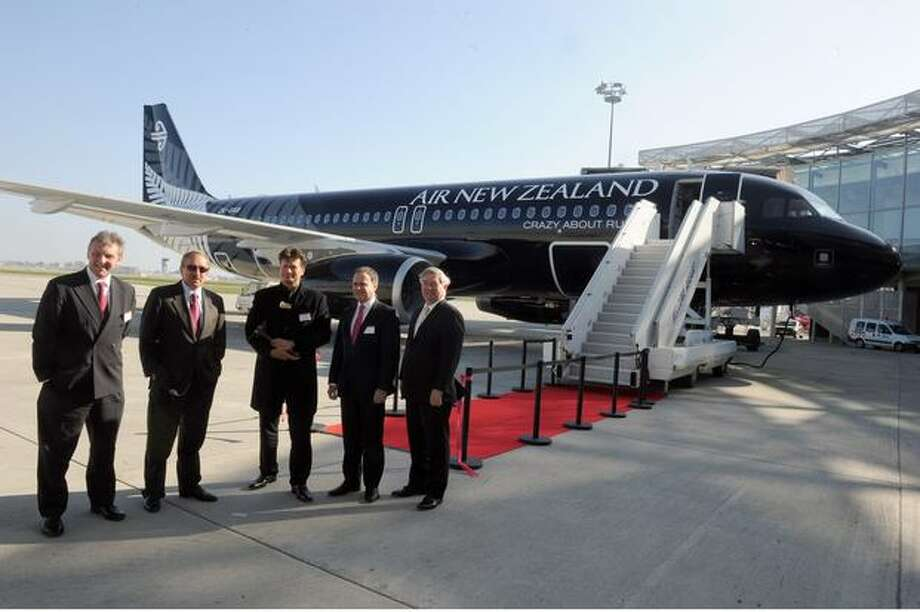 (From right)  Airbus Chief Operating Officer John Leahy, Air New Zealand Financial Chief Executive Officer Rob McDonald, New Zealand's Ambassy employee in charge of Culture Andrew Baker, Air Lease Corporation President Stevan Udvar-Hazy and International Aero Engines President Ian Aitken pose in front of an A320 Airbus delivered to Air New Zealand and painted with the logo of New Zealand rugby national team, the All Blacks. Photo: Getty Images