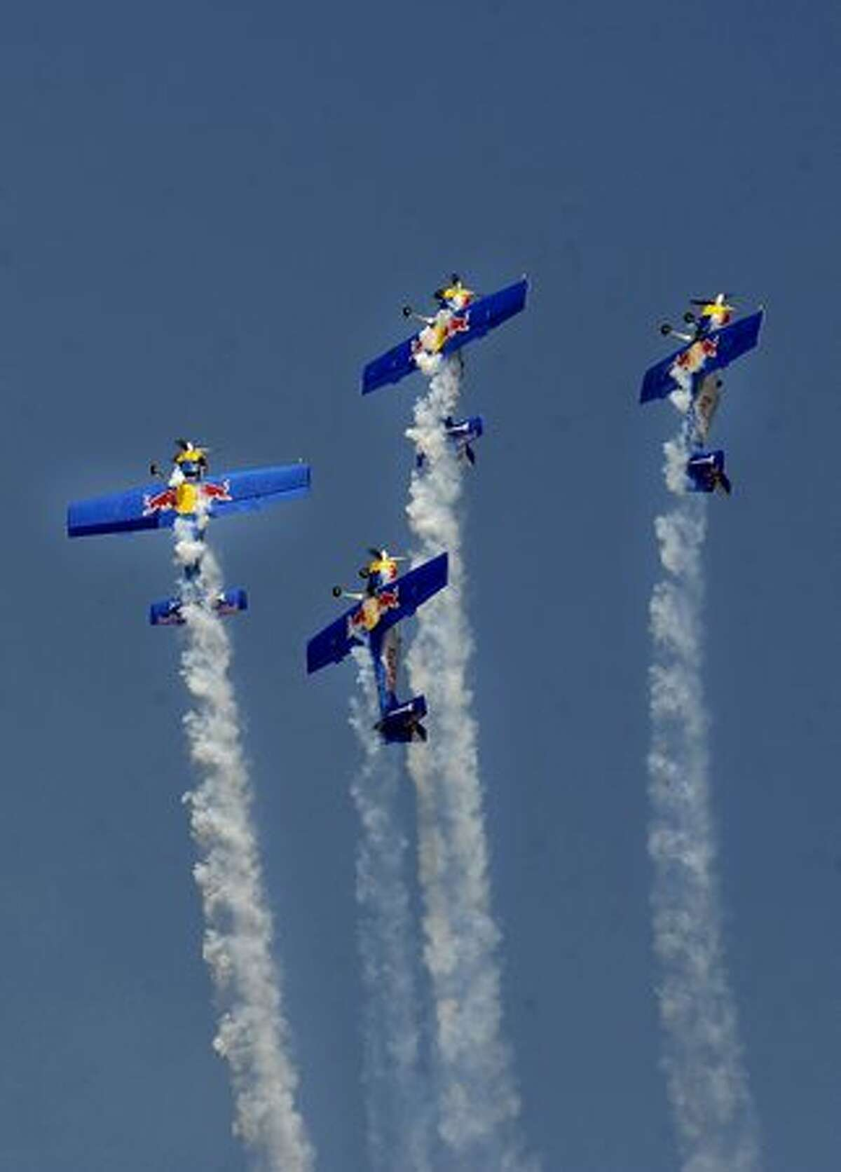 The Red Bull aerobatics team flies in formation on the eve of the Aero India 2011 exposition at the Yelhanka Air Force station in Bangalore.