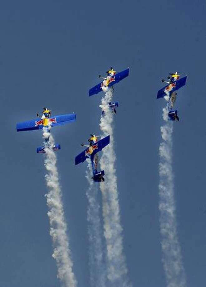 The Red Bull aerobatics team flies in formation on the eve of the Aero India 2011 exposition at the Yelhanka Air Force station in Bangalore. Photo: Getty Images