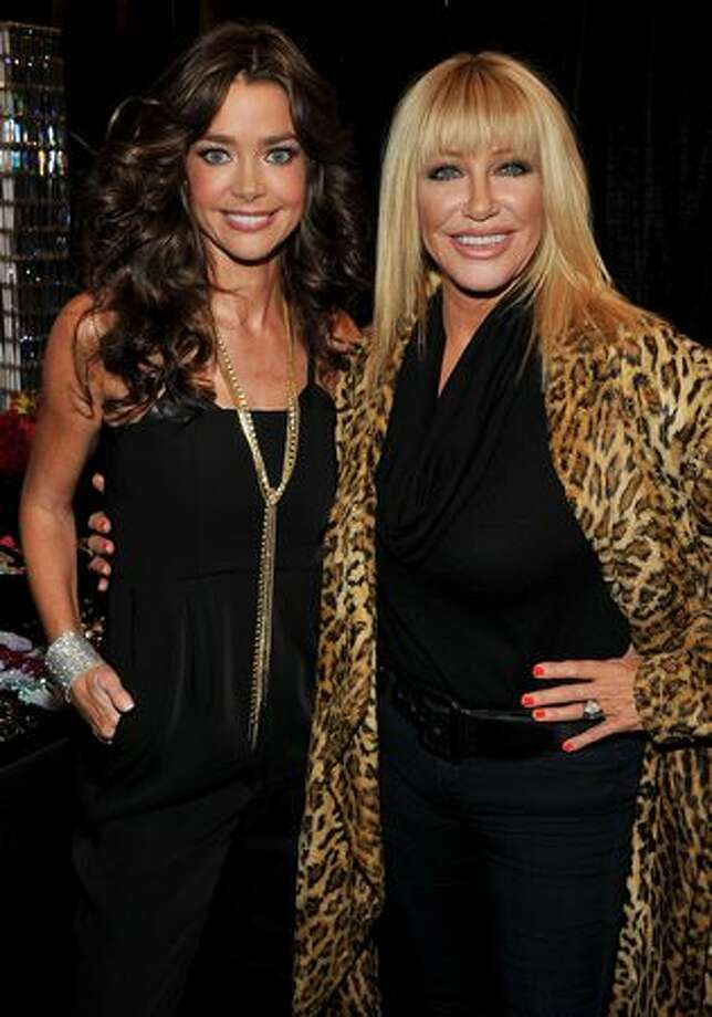 Actresses Denise Richards and Suzanne Somers attend the Heart Truth's Red Dress Collection, kickoff event for Mecerdes-Benz Fashion Week, at The Theatre at Lincoln Center in New York on Wednesday, Feb. 9, 2011. New York Fashion Week, eight days of runway shows previewing designs for next fall and winter, begins Thursday. Photo: Getty Images