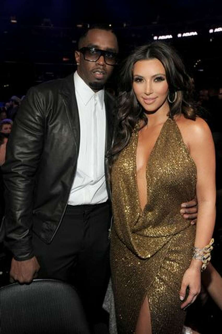 Producer Sean 'Diddy' Combs and TV personality Kim Kardashian arrive at The 53rd Annual GRAMMY Awards held at Staples Center in Los Angeles, California.