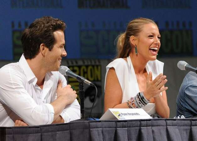 "Actor Ryan Reynolds (L) and actress Blake Lively speak onstage at the ""Green Lantern"" panel discussion. Photo: Getty Images"