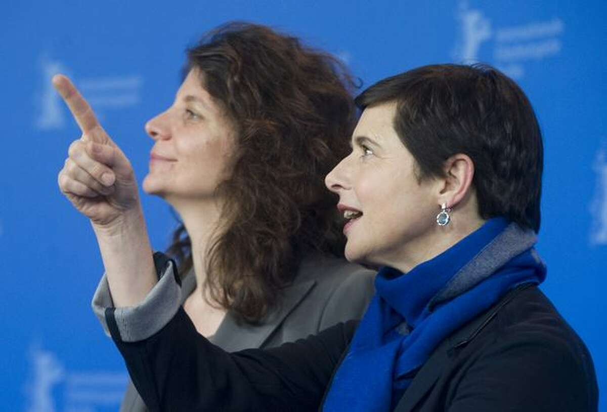 French director Julie Gavras (L) and Italian actress and jury president Isabella Rossellini pose for photographers during a photocall for the film