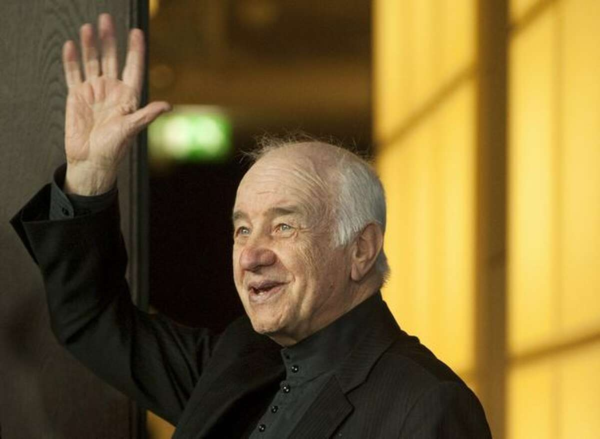 German actor Armin Mueller-Stahl waves as he arrives for a photocall before being given an honorary golden bear in Berlin during the international Berlinale film festival.