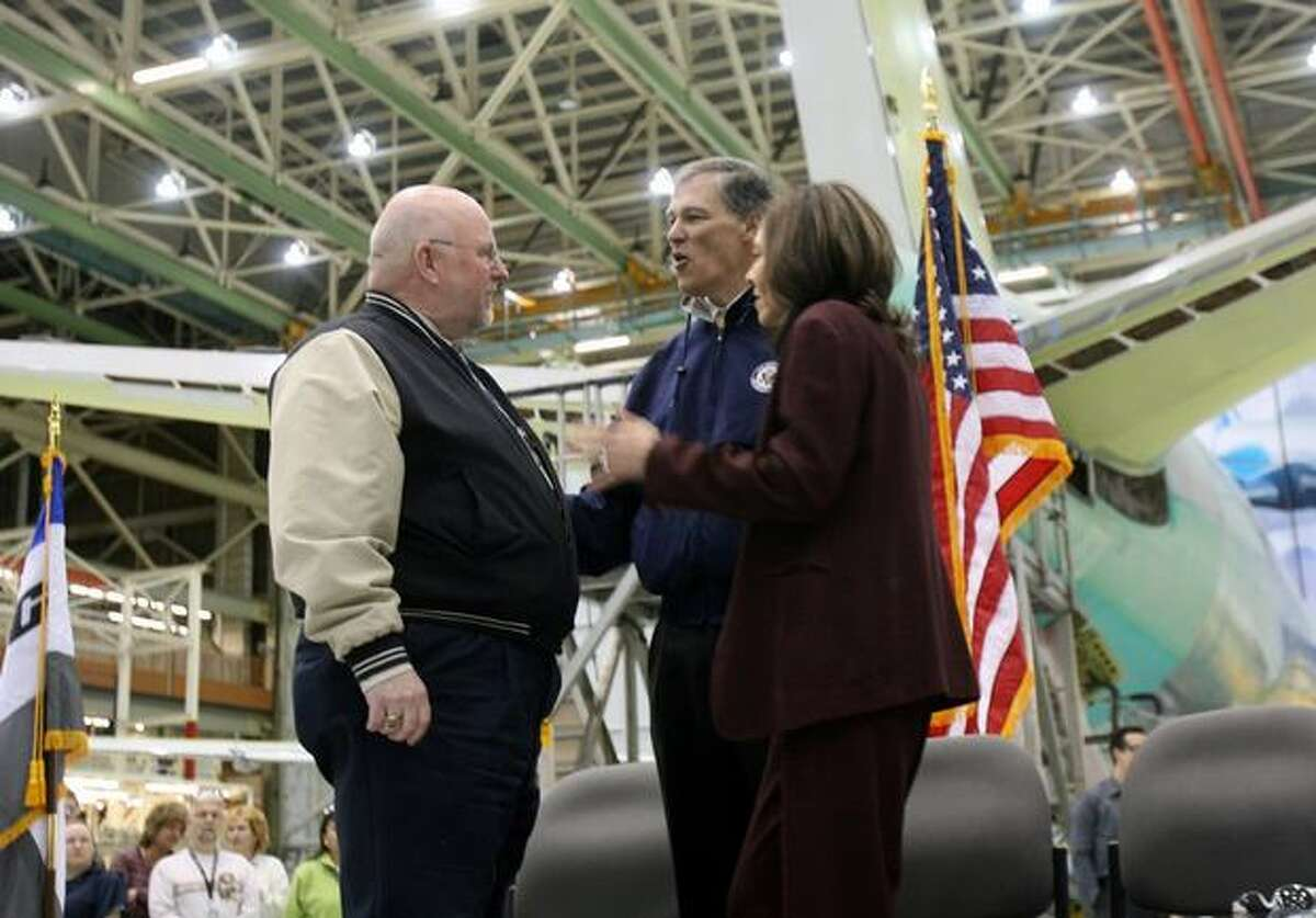 International Association of Machinists and Aerospace Workers District 751 President Tom Wroblewski (left) talks with U.S. Rep. Jay Inslee and U.S. Sen. Maria Cantwell, both D-Wash., before a celebration of Boeing's win of the Air Force's $35 billion aerial refueling tanker contract in Boeing's Everett, Wash., plant.