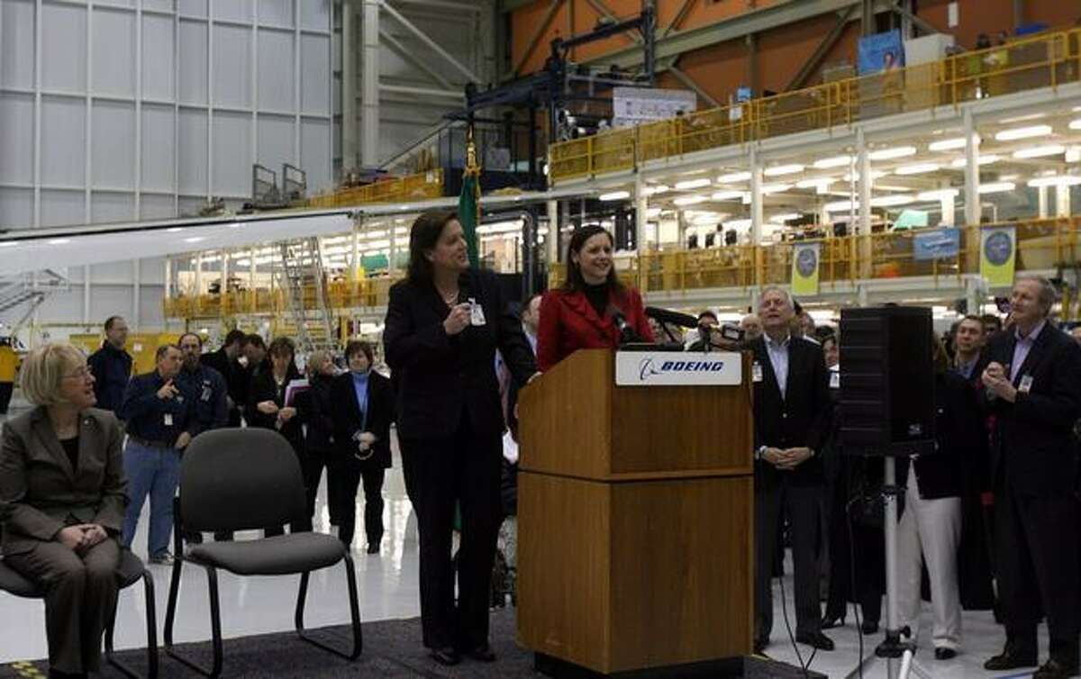 Maureen Dougherty (at podium, on left) vice president and general manager of the KC-46A tanker program for Boeing Defense, Space & Security, and Kim Pastega, vice president and general manager of the Boeing 767 program at Boeing Commercial Airplanes, open a celebration of Boeing's win of the Air Force's $35 billion aerial refueling tanker contract in Boeing's Everett, Wash., plant.