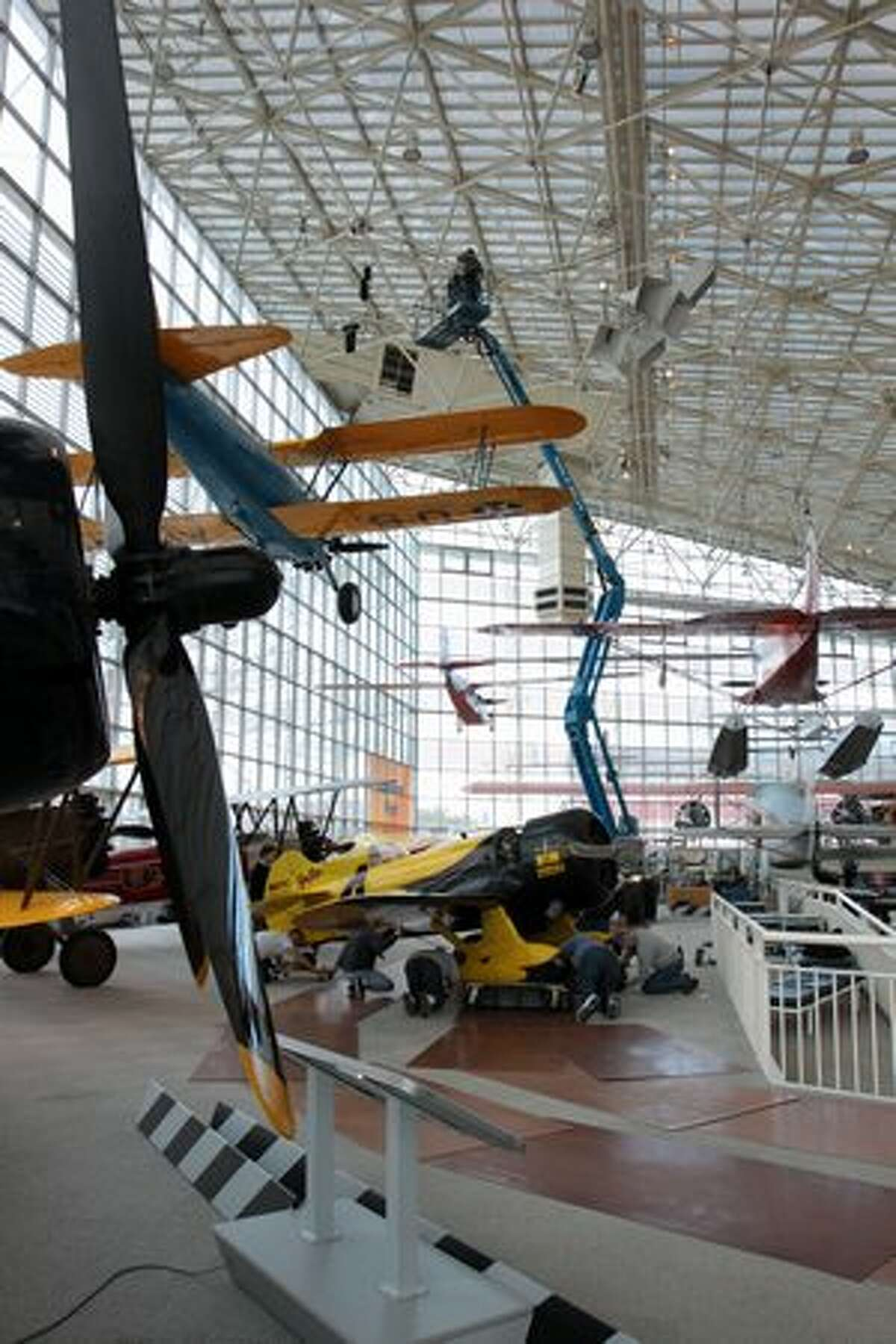 The Museum of Flight prepares to raise its Granville Brothers Gee Bee Z reproduction in its main hall, in Seattle, Wash.