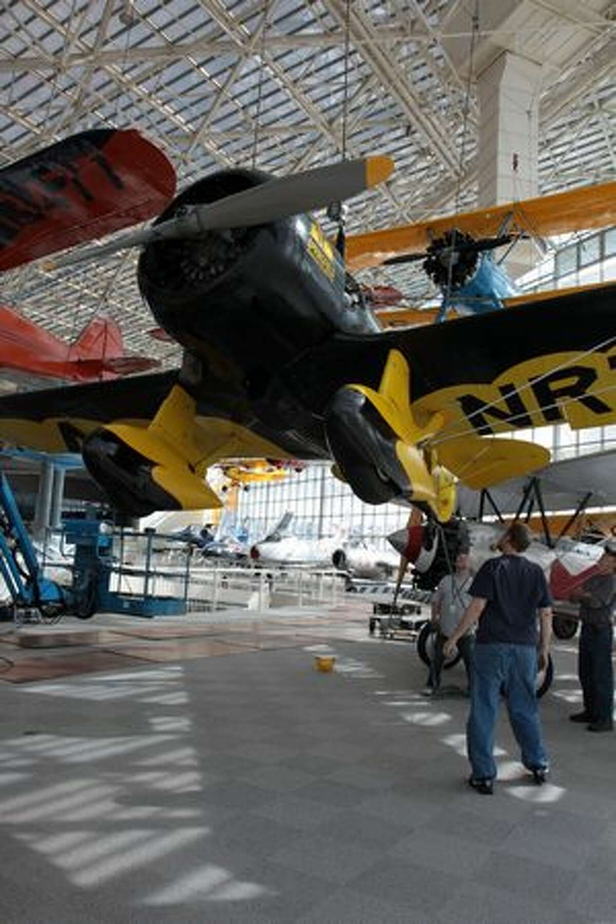 The Museum of Flight raises its Granville Brothers Gee Bee Z reproduction in its main hall, in Seattle, Wash.