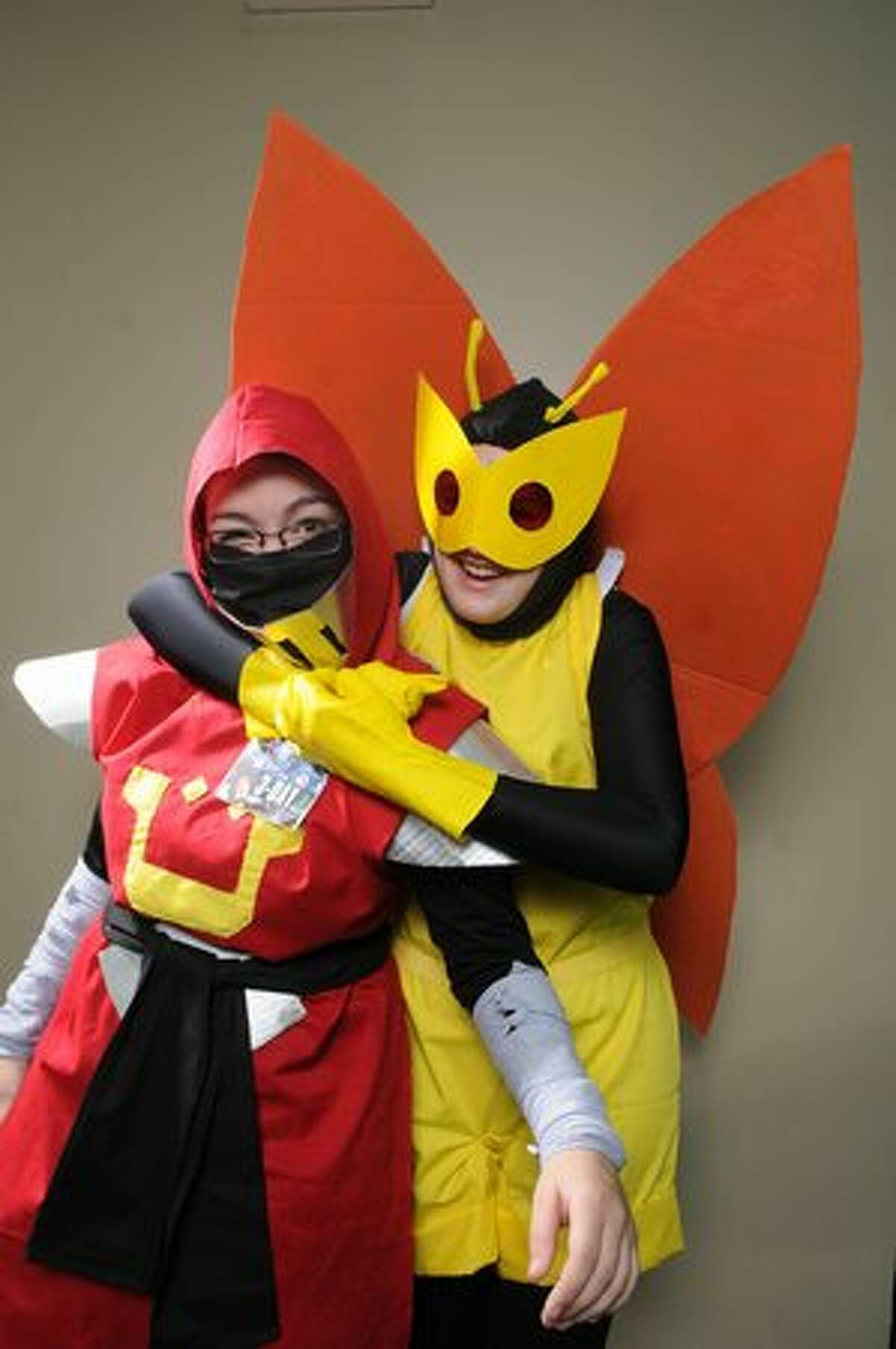 Emily Williamson, left, and Jordan Hopps, who traveled from Dallas for the event, pose as Venture Brothers characters for a portrait at Emerald City Comicon at the Washington State Convention Center in Seattle on Saturday, March 5, 2011.